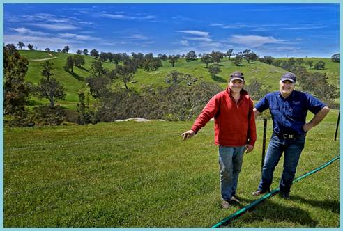 Image above: Glenelg Hopkins CMA Senior Field Services Officer, Rob Addinsall with landholder, Sam Roberts, on his property which was part of the Glenelg River Restoration Project.